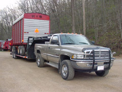 Dodge Ram - Pulling a Repaired H&S Chopper / Forage Box / Wagon on our trailer Back to the Customer, it is our Deliver & Pickup Equipment