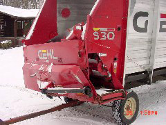Before Pictures of a Wrecked Steel Sided Gehl 980 Chopper Box / Forage Box / Forage Wagon - Head & Box Damage